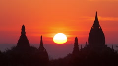 Bagan Myanmar (Burma) - Balloons at sunrise over ancient pagodas and temples - stock footage