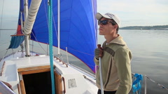 Young athletic man on sailing yacht, extreme sports, active rest Stock Footage