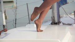 Young female loitering around sailboat. Vacation, holidays Stock Footage