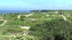 Pan across the bomb craters covering Pointe du Hoc, Normandy, France. Stock Footage