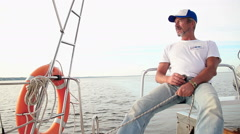 Senior captain on sailboat, outdoor activities, active rest Stock Footage