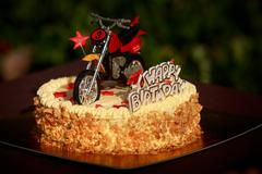 Birthday cake decorated with motorcycle and red stars Stock Photos