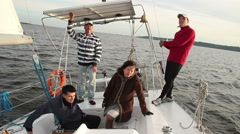 Yacht crew on deck, company, friends, traveling, tourism - stock footage