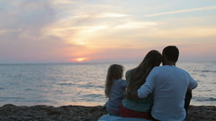 Full of love family enjoy magnificent sunset on the beach - stock footage