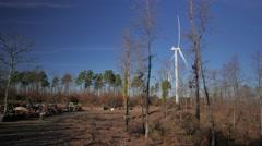 Cutting wood equipment under Wind Farm with Turbine spinning 4k UHD - stock footage