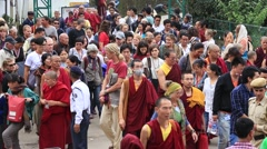 Tibetan monks and people from the lessons of the Dalai Lama in Dharamsala Stock Footage