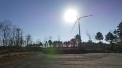 Wind farm with turbines spinning in front of Sun, with big shadows moving 4k UHD Stock Footage