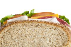 Cropped image of ham sandwich Stock Photos