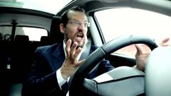 Funny business man getting angry with traffic driving car Stock Footage
