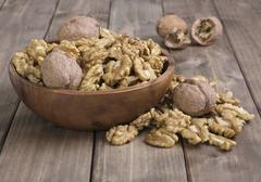 Walnuts in wooden bowl Stock Photos