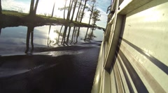 Pontoon boat moving slowly close to the shore Stock Footage