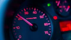 Stock Video Footage of Analogue rev up counter in car