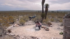 Cleaning ashes of bonfire - stock footage