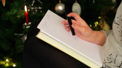 Women try to write letter to Santa Stock Footage