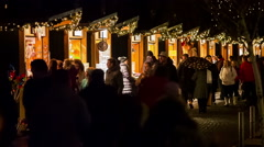 People walking in front of stalls around Christmas time Stock Footage