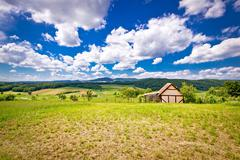 Cottage in idyllic agricultural landscape Stock Photos