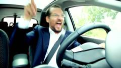 Happy succesful man driving car Stock Footage