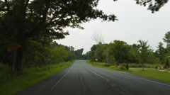 Driving plate: Mid West US rural road, rear view 4K Stock Footage