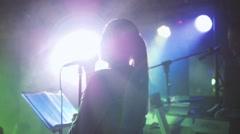 Girl is singing in night club - stock footage