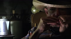 Western Cowboy playing Harmonica, tune time - stock footage
