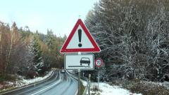 Road warning sign - bad road conditions Stock Footage