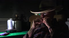Western Cowboy playing Harmonica, hands Stock Footage