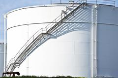 white tanks in tank farm with staircase - stock photo