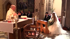 Groom and Bride at the church during mass Stock Footage