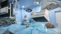 Angiographic surgery: surgeon injects drugs guided by the results of the scanner - stock footage
