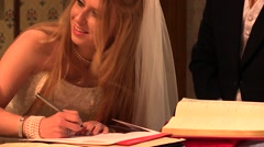 Bride signing the document of marriage in the Church Stock Footage