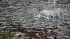 Rain puddle forms under roof gutter Stock Footage