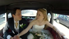 Bride and groom in the car smiling happily after the wedding. Black and White - stock footage