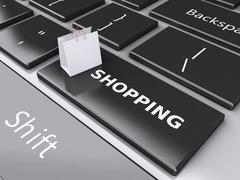 3d shopping bag on computer keyboard. online shopping concept. Stock Illustration
