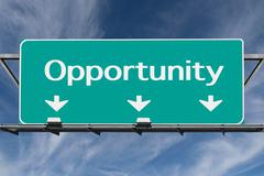 freeway to opportunity road sign with cirrus clouds - stock photo