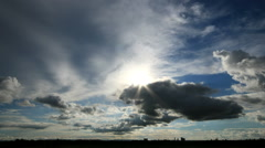 Time lapse of sun light and sky, clouds billowing. Stock Footage