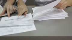 Clinic reception room - filling out paperwork on the reception Stock Footage