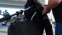 Filling up motorcycle at gas pump Stock Footage