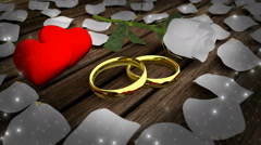 Golden rings and white rose with petals Stock Footage