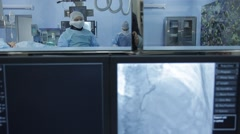 Angiography: A view through the display on the surgeons in the operating room. Stock Footage