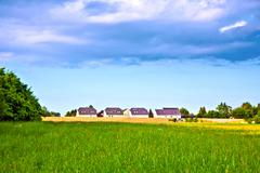noise protection wall with field and houses - stock photo
