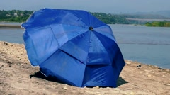 Blue sunshade in the wind Stock Footage