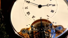 Promotional clock on the wall of the building - stock footage