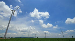 time lapse wind turbines,blue sky and clouds running background. - stock footage