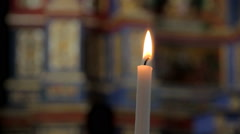Wax candle in chapel Stock Footage