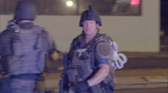 Police in heavy military gear prepare to confront protestors in Ferguson, - stock footage