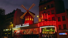 The Moulin Rouge Cabaret at Dusk 4K Stock Video Footage - stock footage