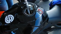 Filling up motorcycle with gas Stock Footage