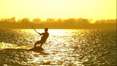 Kitesurfer Silhouette Riding through Sunset in Slow Motion Stock Footage