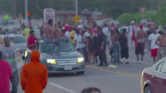 Protesters march , drive by and chant in the streets of Ferguson Missouri. Stock Footage