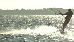 Kitesurfer Silhouette Riding in Slow Motion Stock Footage